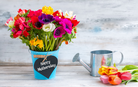 Happy Mothers day reminder with colorful flowers Stock Photo