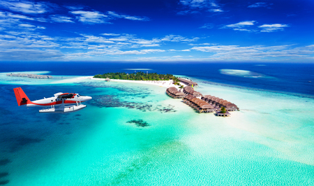 Aerial view of a seaplane approaching island in the Maldives Stock Photo