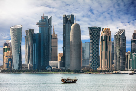 The bay of Doha with a boat, Qatar 에디토리얼