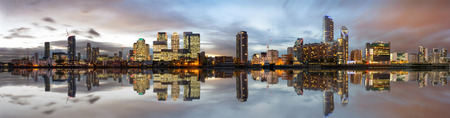Panoramic view to the Docklands and Canary Wharf in London after sunset