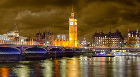 Westminster Bridge and Big Ben on a cloudy winter night, London, United Kingdom