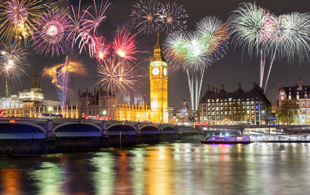 Big Ben and Westminster Bridge in London, United Kingdom, with fireworks Stok Fotoğraf