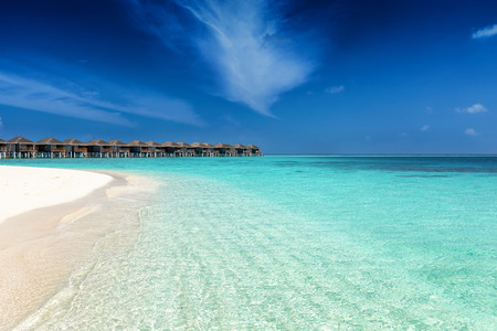 Beautiful, tropical beach in the Maldives with pristine, clear waters and fine sand