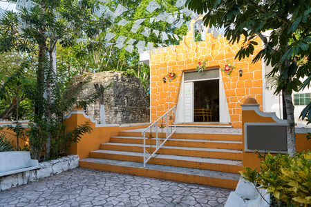 Catholic church next to a Mayan temple in the village of El Cedral on Cozumel island, Quintana Roo, Mexico