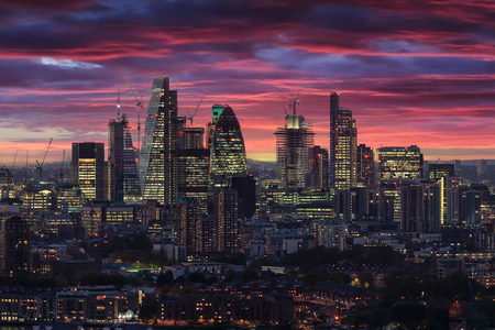 The illuminated City of London after sunset time, United Kingdom Фото со стока