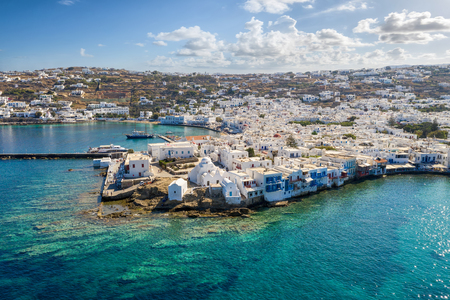 Aerial view of the town of Mykonos island with turquoise sea and whitewashed houses, Cyclades, Greece