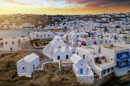 Aerial view to the Paraportiani Church in Mykonos town, Cylcades, Greece, during sunset time
