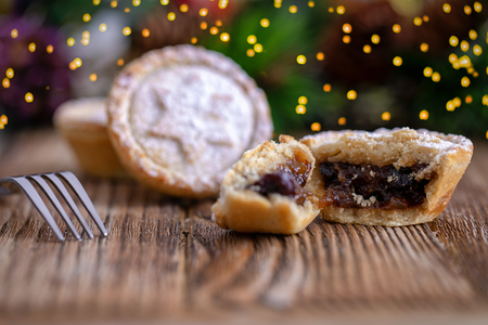 Closeup of a traditional, british mince pie for Christmas on a wooden surface