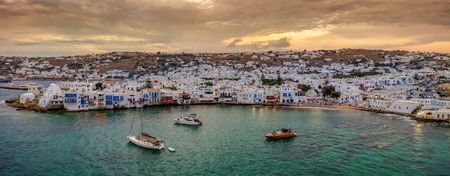 Panoramic view to the bay and town of Mykonos island during sunset time, Cyclades, Greece