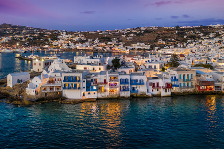 Aerial view to the town of Mykonos with the numerous bars and restaurants by the sea during sunset time, Cyclades, Greece