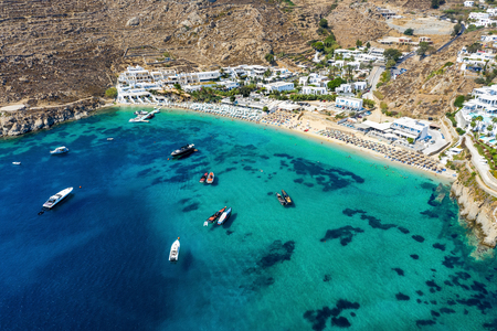 Aerial view to the famous celebrity beach of Psarou on the island of Mykonos, Cyclades, Greece Фото со стока