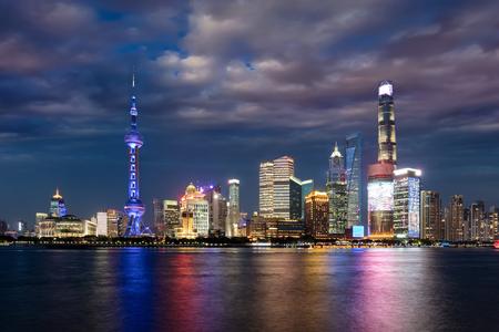 View to the illuminated, urban skyline of Shanghai at dusk, China