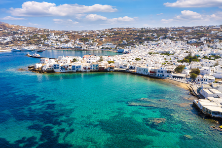 Aerial view to the town of Mykonos island with whitewashed houses and turquoise sea, Cyclades, Greece