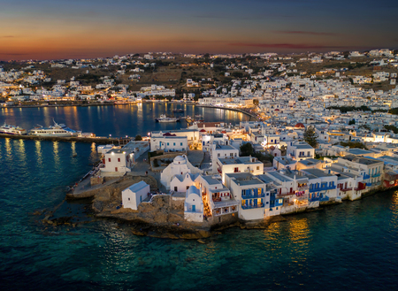 View to the illuminated town of the island of Mykonos just after summer sunset time, Cyclades, Greece