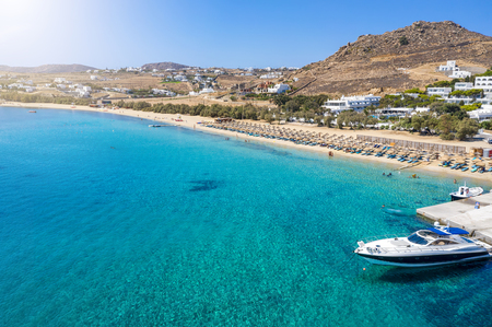 Aerial view to the popular Kalafatis Beach on Mykonos island with pristine, clear sea, Cyclades, Greece Фото со стока