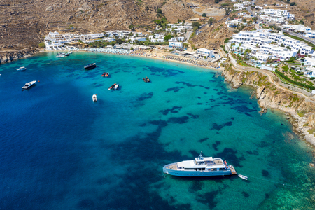 Aerial view to the famous Psarou beach with the high class hotels and reesorts on Mykonos island, Cyclades, Greece