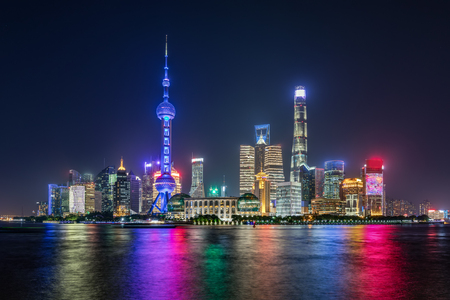 The modern skyline of downtown Shanghai in China during night time