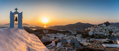 Panoramic view over the town of Ios island in the Cyclades, Greece, during sunset tim Фото со стока