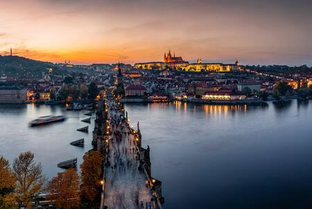 Sunset evening view over the gothic style Charles Bridge in Prague, Czech Republic, to the old Lesser Town and Castle on top of the hill