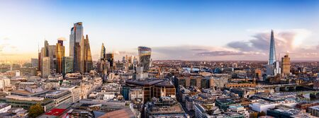 The new constructed skyline of London, United Kingdom, with the modern office buildings of the City until Tower Bridge and Thames river during sunset time
