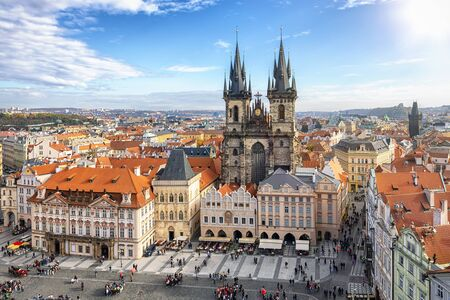 Elevated view to the Gothic style Tyn Church at the old town square of Prague, Czech Republic, during a sunny autumn day
