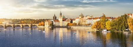 Panoramic view to the beautiful city of Prague, Czech Republic, during autumn time featuring Charles Bridge, Vltava River and the old townscape Stock Photo