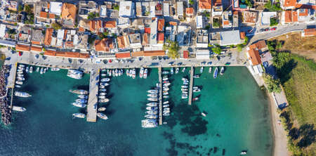 Aerial top down view to the waterfront and marina of Perdika village on the Greek island of Aegina, Saronic Gulf