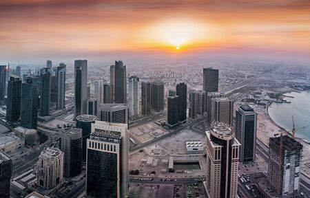Panoramic view to the skyscrapers of the City Center of Doha, West bay district, during a hazy sunset, Qatar
