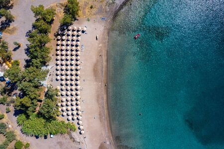 Aerial top down view to the popular beach of Klima with turquoise sea on the island of Aegina, Greece