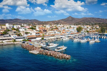 Panoramic view to the small village of Perdika, a hub for sailors and tourists, on the island of Aegina, Saronic Gulf, Greece Stock Photo