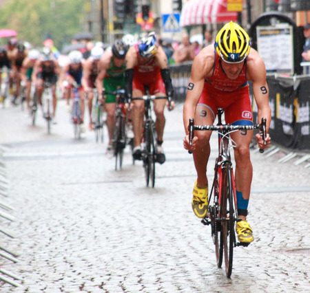 STOCKHOLM - AUG 23, A lot of competitors struggeling in the rain during the triathlon race Mens triathlon ITU World Triathlon series event Aug 23, 2014 in Stockholm, Sweden
