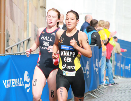 STOCKHOLM - AUG 23, Triathlete Anja Knapp (GER) one meter before Lucy Hall (GBR) in the Womens Triathlon ITU World Triathlon series event Aug 23, 2014 in Stockholm, Sweden
