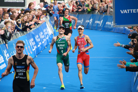 mario: STOCKHOLM - AUG 23, Richard Murray (South Africa) and Mario Mola (Spain) has a tough fight to reach the 4th place after the broze medalist Gregor Buchholz (GER) in the ITU World Triathlon in Stockholm, Sweden