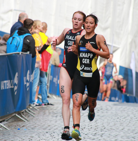 anja: STOCKHOLM - AUG 23, Triathlete Anja Knapp (GER) one meter before Lucy Hall (GBR) in the Womens Triathlon ITU World Triathlon series event Aug 23, 2014 in Stockholm, Sweden