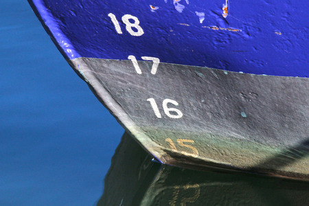 16 17: The bow of a fishingboat reflecting in the water Stock Photo