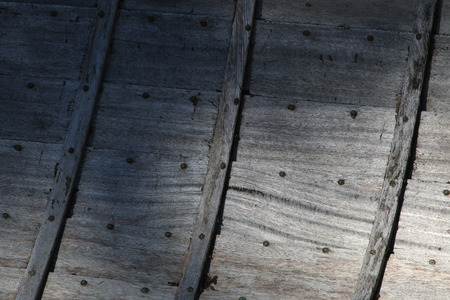 The inside of an old rowboat showing the grey planks photo