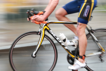 triathlete: STOCKHOLM - AUG 23: A Rapid triathlete cycling in the Men