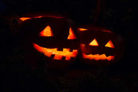 Two halloween pumpins glowing in the dark Stock Photo