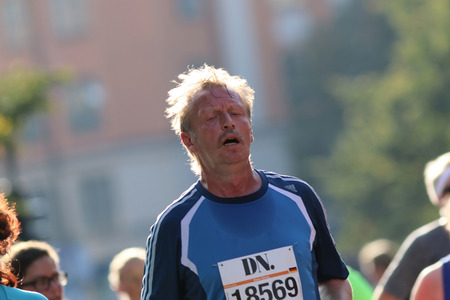 attac: STOCKHOLM - SEPTEMBER 13, 2014: Very tired running man in the Half marathon running event (21 km), Sept 13, 2014 in Stockholm, Sweden Editorial