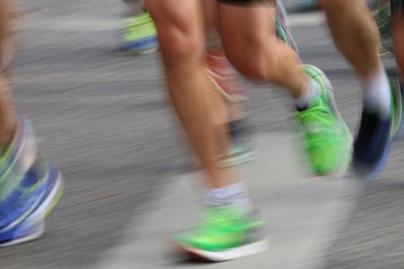 STOCKHOLM - SEPTEMBER 13, 2014: Running colorful feet in the sun in the Half marathon running event (21 km), Sept 13, 2014 in Stockholm, Sweden Editorial