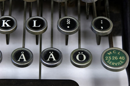 foreign secretary: Foreign letters on an old typewriter, closeup