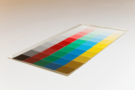 Colorful patches of different shades of  yellow, blue, green, red and gray photo