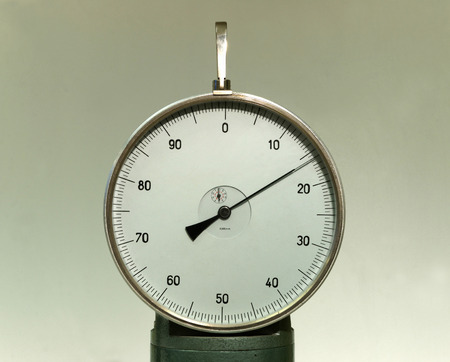 sceince: Cicular measurement device with a pointer indicator, retro style