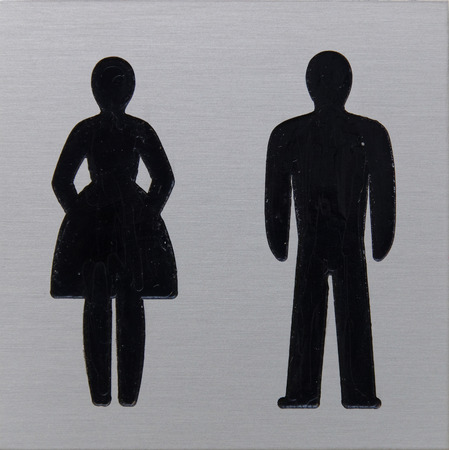 Toilet sign with silhouette of a woman and a man photo