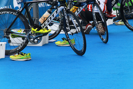 STOCKHOLM - AUGUST 23, 2014: Many sports bicycles in the transition zone prepared for triathlon competition the ITU World Triathlon series event August 23, 2014 in Stockholm, Sweden