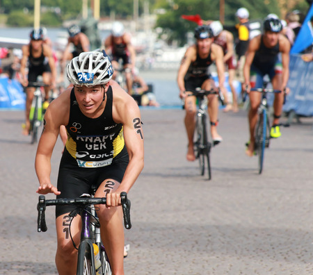 anja: STOCKHOLM - AUG 23: Anja Knapp (GER) cycling after the swimming in the transition zone in the Women Editorial