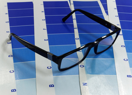 Close-up of glasses on a test print inclding many cyan tone areas photo
