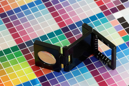 Close-up of a loupe on a multi color test print Stock Photo