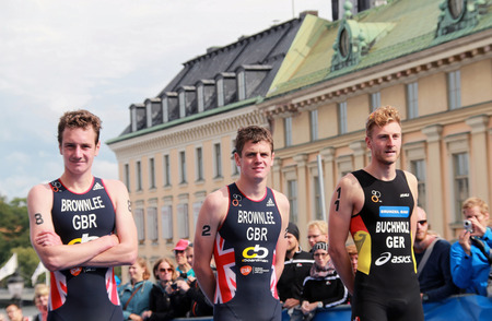 bronz: STOCKHOLM - AUG 23, 2014:, Alistar Brownlee (Silver medalist), Jonathan brownlee(gold medalist), Gregor Buchholz (bronz medalist) during the prize ceremony in the triathlon race Mens ITU World Triathlon series event August 23, 2014 in Stockholm, Sweden