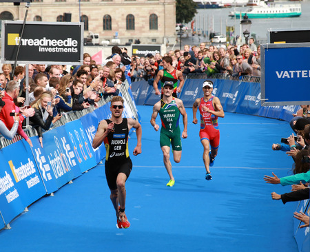 richard: STOCKHOLM - AUG 23, 2014: Tough fight between Richard Murray (South Africa) and Mario Mola (Spain) and Gregor Buchholz (GER) in the Menss ITU World Triathlon series event August 23, 2014 in Stockholm, Sweden Editorial